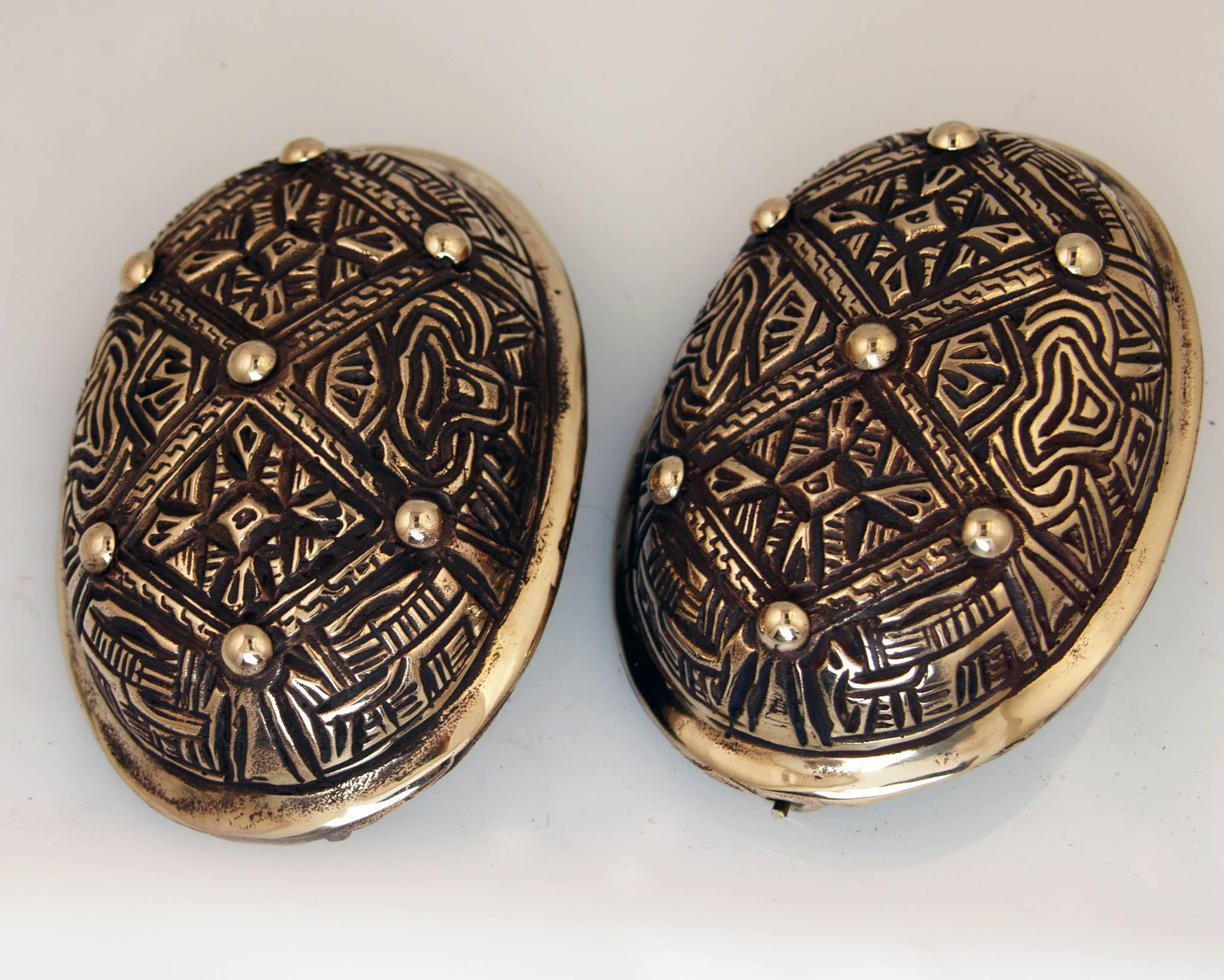 Chip carved tortoise brooches